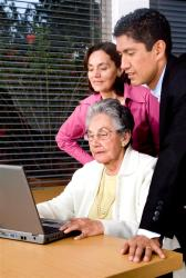 an elderly lady on a laptop with her probate attorney and daughter.